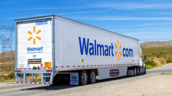 Apple Valley, CA / USA - May 16, 2020: A Walmart semi truck trailer on a Mojave Desert road in Apple Valley, California.(Apple Valley, CA / USA - May 16, 2020: A Walmart semi truck trailer on