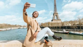 A woman takes a selfie in Paris.