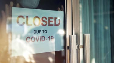 """A """"Closed Due to COVID-19"""" sign"""