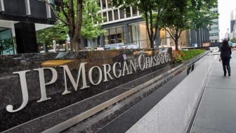 NEW YORK, NY - AUGUST 12:A woman walks past JP Morgan Chase's corporate headquarters on August 12, 2014 in New York City. U.S. banks announced second quarter profits of more than $40 billion,
