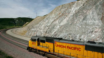 SAN BERNARDINO, CA - MAY 15:A freight train passes diagonally-shifted layers of earth as it crosses the San Andreas Rift Zone, the system of depressions in the ground between the parallel fau