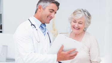 Doctor and patient discussing over reports