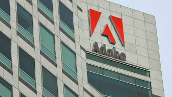 SAN JOSE, CA - JANUARY 15:The Adobe logo is displayed on the side of the Adobe Systems headquarters January 15, 2010 in San Jose, California. Adobe Systems has added 20 new wind turbines to t