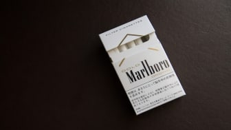 Osaka, Japan - December 14, 2014: Japanese Box of Marlboro Gold cigarettes. Marlboro is a trademark of Philip Morris International and one of the top global brand names.