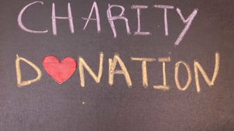 "picture ""charity donation"" written on blackboard"