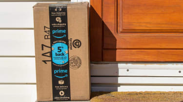 An Amazon package sits on a suburban front porch