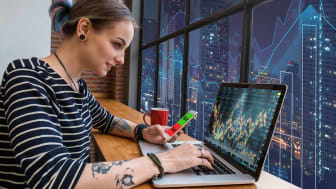 Hipster young Woman freelancer using the technology laptop and smart phone mobile showing trading graph with the stock exchange trading graph screen background, Business financial and forex c