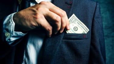 Businessman putting dollar banknotes money in his suit pocket, elegant businessperson with cash.