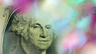 a blurred image of George Washington on the dollar bill