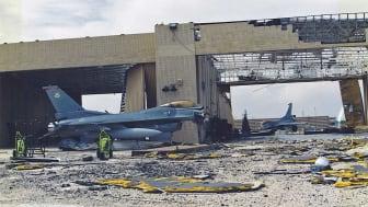 Photo of damaged aircraft, hanger