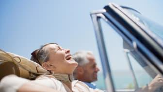Senior couple taking a joyful ride in a convertible