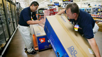 PALMDALE, CA - AUGUST 18:Wal-Mart employees Robert Jimenez (L) and Tom Ondrey stock merchandise at the soon-to-be-opened Wal-Mart Palmdale Supercenter department store on August 18, 2005 in P