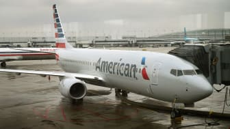 CHICAGO, IL - JANUARY 29:A new American Airlines 737-800 aircraft featuring a new paint job with the company's new logo sits at a gate at O'Hare Airport on January 29, 2013 in Chicago, Illino