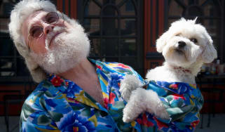 Senior man holding lookalike dog