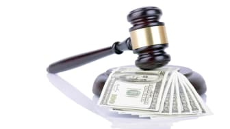 picture of judge's gavel hitting money