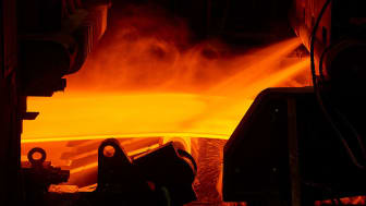 Hot steel slab being rolled.(Photo by Roger Ball/Worldsteel via Getty Images)