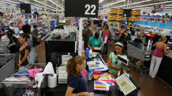 NORTH MIAMI, FL - AUGUST 14: People make their way through the checkout as they make purchases at a Wal-Mart Stores August 14, 2008 in North Miami, Florida. The company reported second-quarte