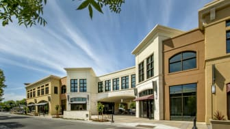Commercial building with restaurants and retail on ground floor, office space above.