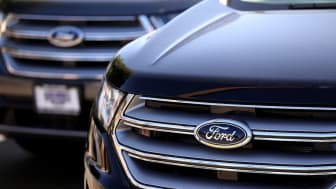 Two Ford vehicles shown on a dealer's lot
