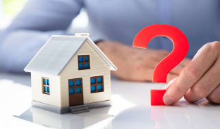 Illustration shows a toy home with a big question mark next to it.