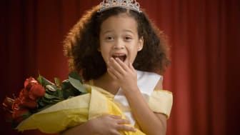 picture of young girl winning beauty contest