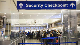 Los Angeles, California, USA-December 2017: Airport Sign at the entrance of the security checkpoint in LAX airport with People waiting in line.