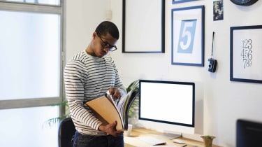Young man looking through financial records.