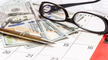 picture of money, glasses and a pen on a calendar