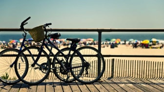 Bicycles parked on a beach boardwalk