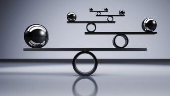 Metal balls balancing on beams