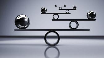 Metal balls balancing on beams