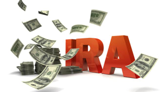 picture of the letters I-R-A with money floating around them