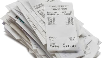 A stack of store receipts