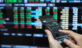 a person looks at his stocks on a phone
