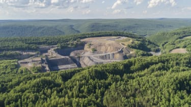 The aerial view from a drone to the open-cast mine in Lehigh Valley, Carbon County, Pennsylvania, USA. The sunny summer day.