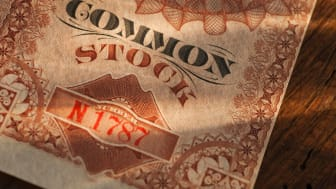The corner of a stock certificate