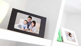 Happy Family photo on white bookshelf at home