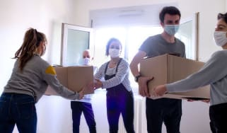 Couple moving with help of friends