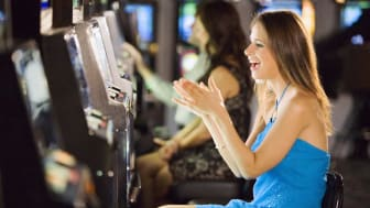 picture of woman at slot machine
