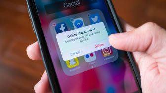 Bangkok, Thailand - March 23, 2018 : Facebook user deleting Facebook application on iPhone 7.