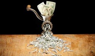 Dollar going through a shredder