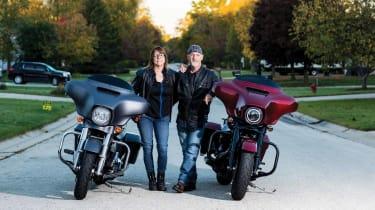 Kip Rupple and Roni Kramer posing next to their motorcycles