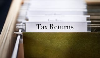 picture of a folder containing tax returns in a filing cabinet