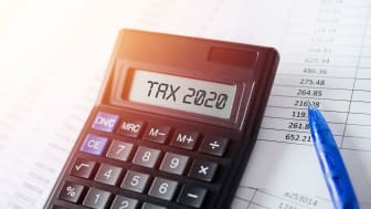 """picture of calculator with """"Tax 2020"""" showing on the screen"""