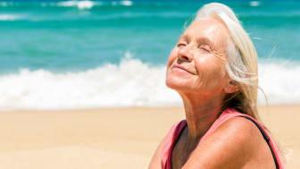 A senior woman suns herself on a Florida beach