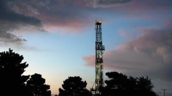beautiful sky over busy oilfields