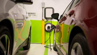 picture of electric car charging in a garage