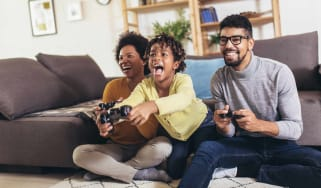 picture of family playing video games in their living room