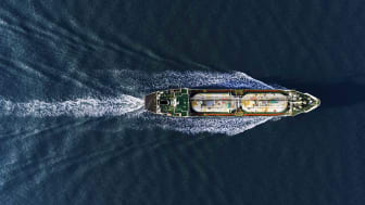 Aerial top view Ship tanker Liquefied Petroleum Gas (LPG)full speed with beautiful wave patter delivery energy from refinery.