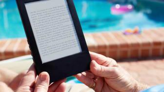 Senior reading on a Kindle device